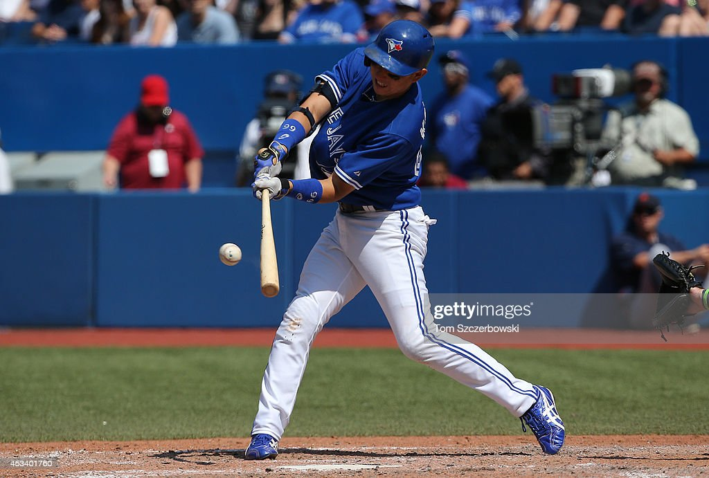 Munenori Kawasaki #66 of the Toronto Blue Jays flies out in the eighth inning during MLB game action against the Detroit Tigers on August 9, 2014 at Rogers Centre in Toronto, Ontario, Canada.