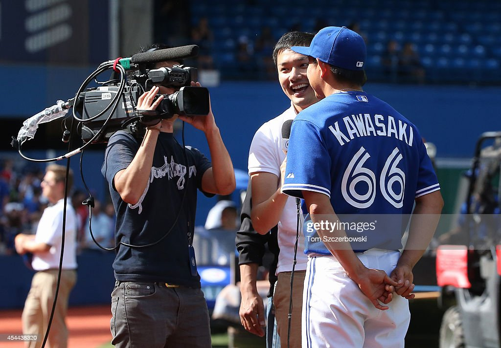 Munenori Kawasaki #66 of the Toronto Blue Jays gives an interview after their victory during MLB game action against the New York Yankees on August 31, 2014 at Rogers Centre in Toronto, Ontario, Canada.