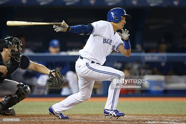 Munenori Kawasaki of the Toronto Blue Jays hits an RBI groundout in the fifth inning during MLB game action against the Seattle Mariners on September...