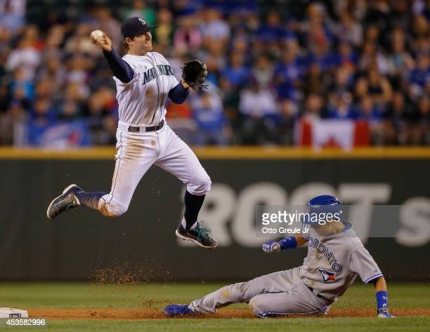 Munenori Kawasaki of the Toronto Blue Jays is put out at second base on a fielder's choice play as shortstop Brad Miller of the Seattle Mariners...