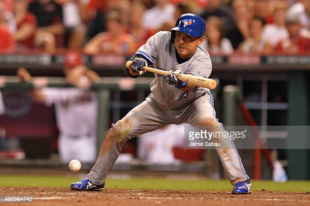 Munenori Kawasaki of the Toronto Blue Jays lays down a sacrifice bunt in the ninth inning against the Cincinnati Reds at Great American Ball Park on...