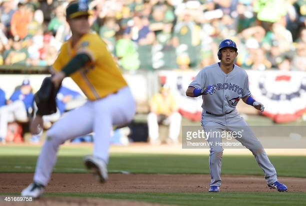 Munenori Kawasaki of the Toronto Blue Jays leads off first base against the Oakland Athletics in the top of the fourth inning at Oco Coliseum on July...