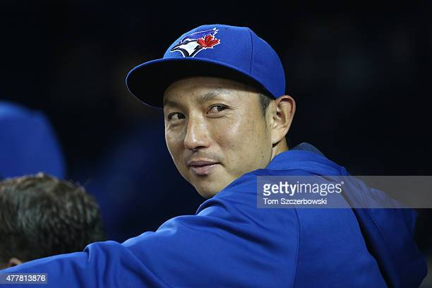 Munenori Kawasaki of the Toronto Blue Jays looks on from the dugout during MLB game action against the Baltimore Orioles on June 19 2015 at Rogers...