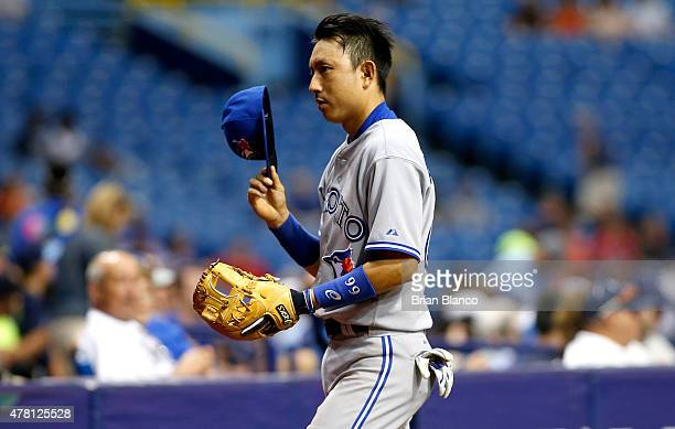 Munenori Kawasaki of the Toronto Blue Jays makes his way to the gugout following the second inning of a game against the Tampa Bay Rays on June 22...