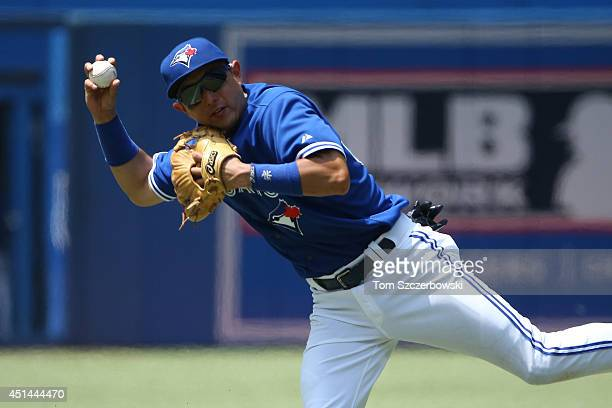 Munenori Kawasaki of the Toronto Blue Jays makes the play on a grounder and throws out the baserunner in the fourth inning during MLB game action...