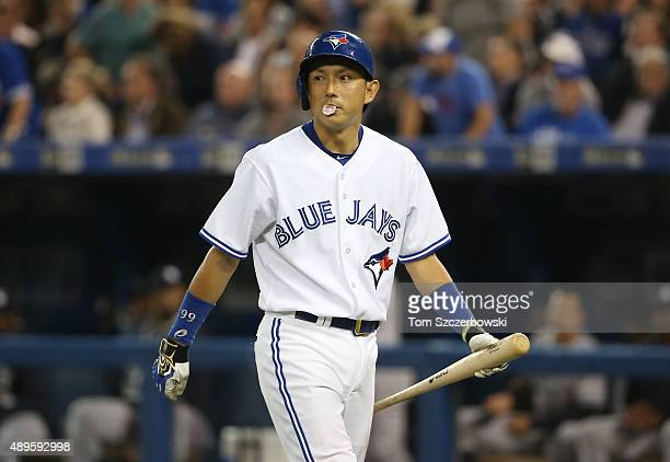 Munenori Kawasaki of the Toronto Blue Jays reacts after being called out on strikes in the fifth inning during MLB game action against the New York...