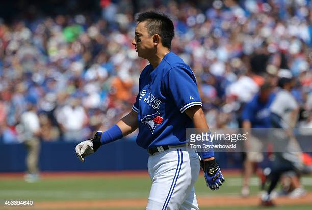 Munenori Kawasaki of the Toronto Blue Jays reacts after striking out to end the fifth inning during MLB game action against the Detroit Tigers on...
