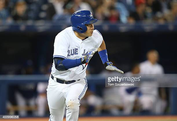Munenori Kawasaki of the Toronto Blue Jays runs down the firstbase line as he lines out to center field to end the fourth inning during MLB game...