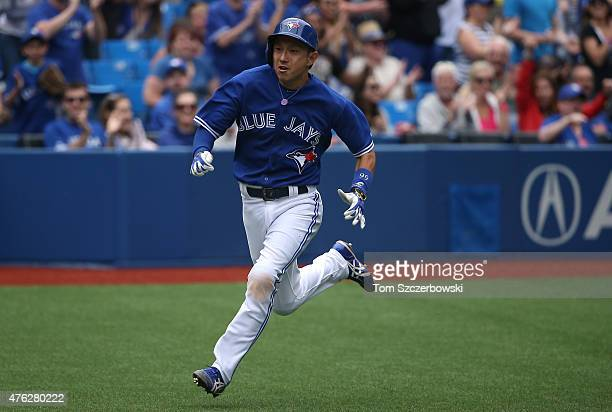 Munenori Kawasaki of the Toronto Blue Jays runs home to score a run on an RBI single by Jose Reyes in the ninth inning during MLB game action against...