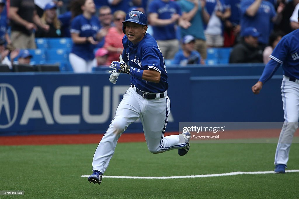 Munenori Kawasaki #66 of the Toronto Blue Jays runs home to score a run on an RBI single by Jose Reyes #7 in the ninth inning during MLB game action against the Houston Astros on June 7, 2015 at Rogers Centre in Toronto, Ontario, Canada.