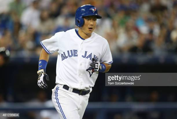 Munenori Kawasaki of the Toronto Blue Jays runs to first base after drawing a walk in the fifth inning during MLB game action against the New York...