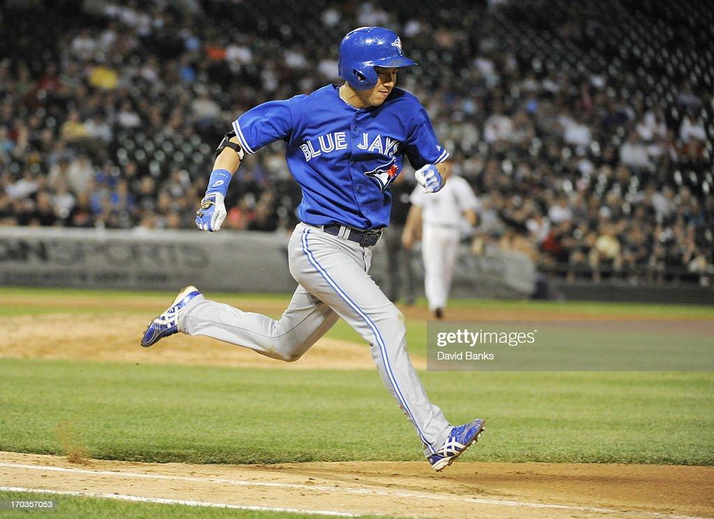 Munenori Kawasaki #66 of the Toronto Blue Jays runs to first base against the Chicago White Sox on June 11, 2013 at U.S. Cellular Field in Chicago, Illinois.
