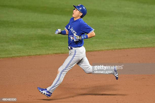 Munenori Kawasaki of the Toronto Blue Jays runs to second base in the fifth inning during a baseball game against the Baltimore Orioles at Oriole...