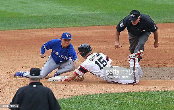Munenori Kawasaki of the Toronto Blue Jays tags out Gordon Beckham of the Chicago White Sox as second base umpire Tim Welke watches the play in the...