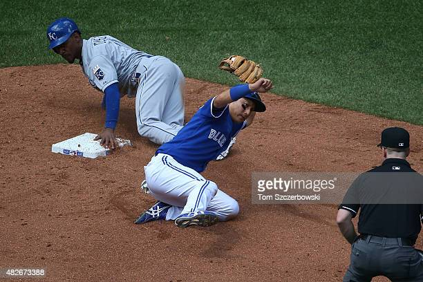 Munenori Kawasaki of the Toronto Blue Jays tags out Jarrod Dyson of the Kansas City Royals as he tries to steal second base in the eighth inning...