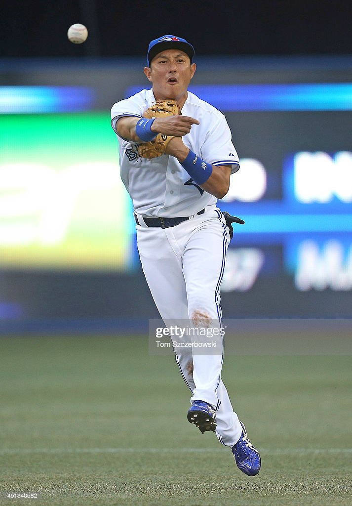 Munenori Kawasaki #66 of the Toronto Blue Jays throws out the baserunner in the first inning during MLB game action against the Chicago White Sox on June 27, 2014 at Rogers Centre in Toronto, Ontario, Canada.