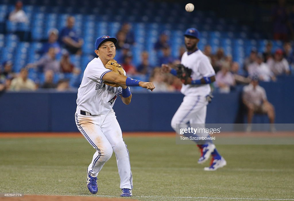 Munenori Kawasaki #66 of the Toronto Blue Jays throws out the baserunner in the eighth inning during MLB game action against the Boston Red Sox on July 22, 2014 at Rogers Centre in Toronto, Ontario, Canada.