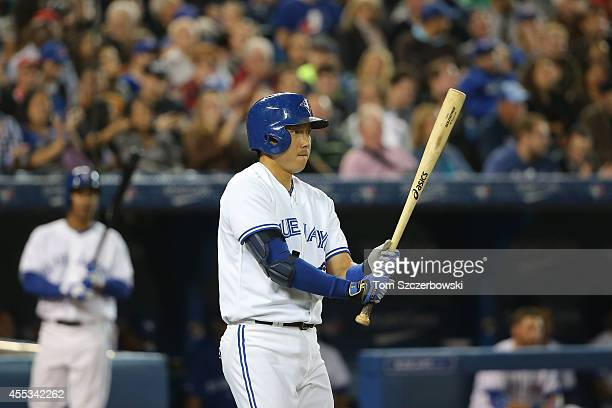 Munenori Kawasaki of the Toronto Blue Jays walks up to home plate as he pinch hits in the seventh inning during MLB game action against the Tampa Bay...