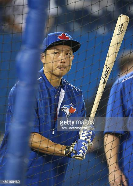 Munenori Kawasaki of the Toronto Blue Jays warms up during batting practice before the start of MLB game action against the Boston Red Sox on...