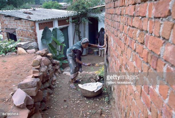 Muni Bai mother of nine children and from the Dalit caste scoops out human excrement from a latrine October 1 1997 in Bhopal India Muni Bai earns 800...
