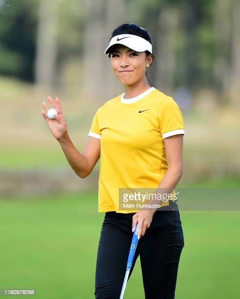Muni He of China plays waves at the 18th green during the Aberdeen Standard Investment Scottish Open at The Renaissance Club on August 10 2019 in...