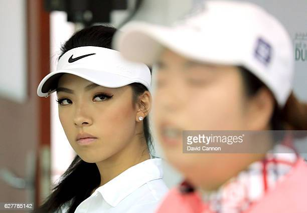 Muni He of China the young amateur prodigy with Shanshang Feng of China the defending champion during their media conference as a preview for the...