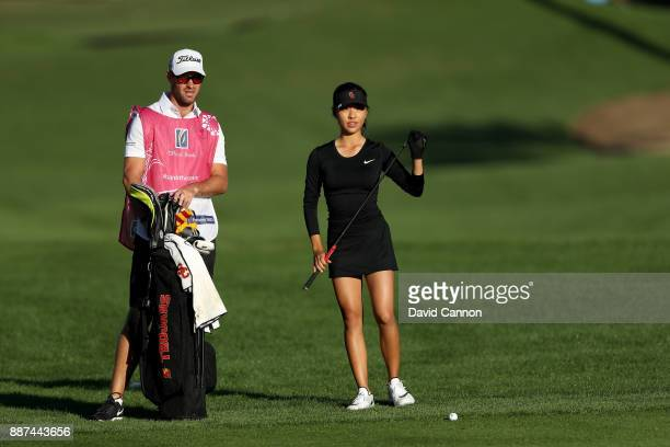 Muni He of China waits to play her third shot on the par 5 10th hole with her caddie Stephen Deane of Northern Ireland during the second round of the...