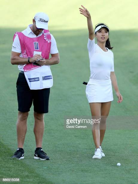 Muni He of China with her caddie Stephen Deane of Northern Ireland who is the head teaching professional at The Emirates Golf Club before her second...