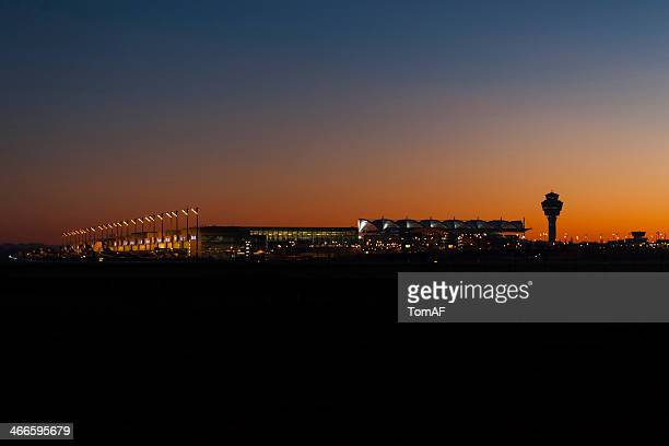 munich airport at night - munich airport stock photos and pictures