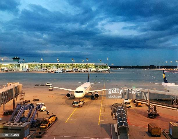 munich airport gates with lufthansa airplane, germany - munich airport stock photos and pictures