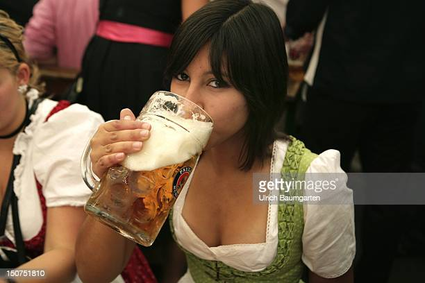 GERMANY MUNICH Munich Beer Festival Oktoberfest Muenchen There probably someone has looked too deeply in the beerglass young woman with a beer jug...