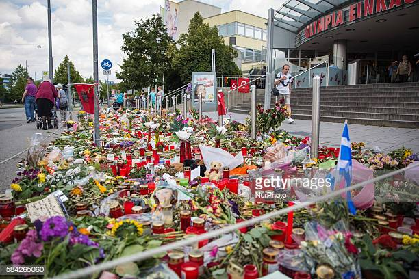 Munich citizens on 28 July 2016 lay down flowers at the olympia shopping mall after a gunman killed nine people last friday