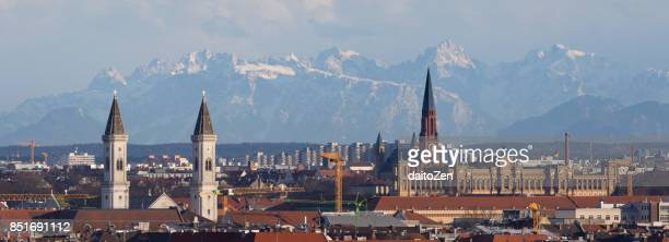 Munich Cityscape with churches, Bavarian State Parliament and mountain range in the distance, Munich, Bavaria, Germany