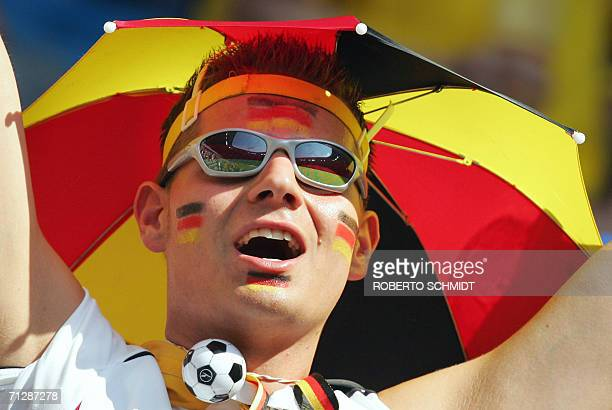 A German fan cheers at Munich's World Cup Stadium ahead of the start of the round of 16 World Cup football match between Germany and Sweden 24 June...