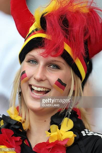 A German fan smiles at Munich's World Cup Stadium ahead of the start of the round of 16 World Cup football match between Germany and Sweden 24 June...