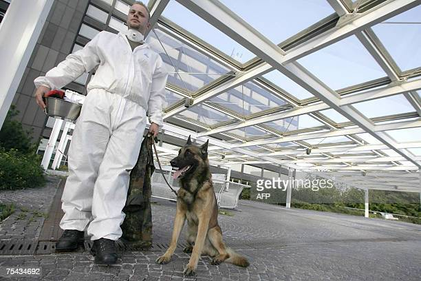 Soldier of the Federal Armed Forces Bundeswehr and his sniffer dog wait in front of a military hospital in Ulm, southern Germany, after German...