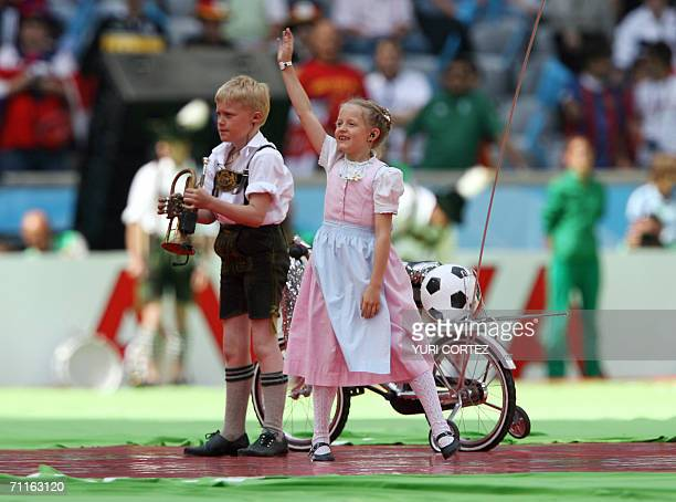 A young boy and girl in traditional costume take part in opening festivities at Munich's World Cup Stadium ahead of the opening 2006 World Cup match...