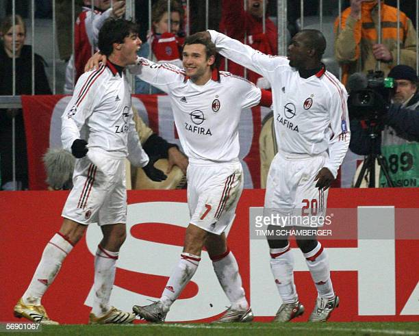 AC Milan's forward Andriy Shevchenko celebrates with teammates Kaka and Clarence Seedorf after he scored a penalty against Bayern Munich 21 February...