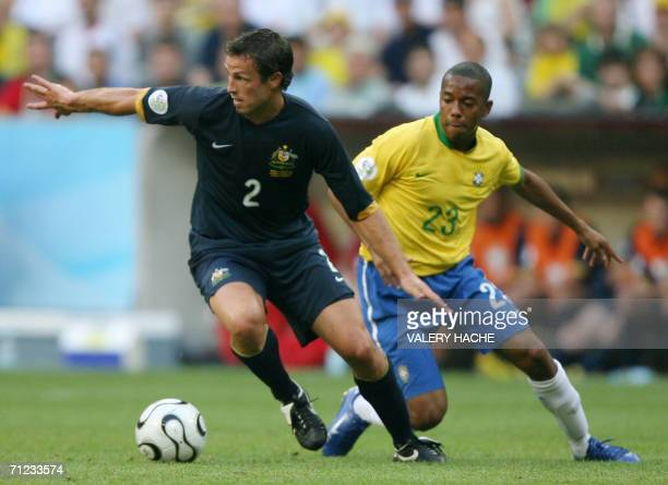 Australian defender Lucas Neill tries to fend off Brazilian forward Robinho in their opening round Group F World Cup football match at Munich's World...