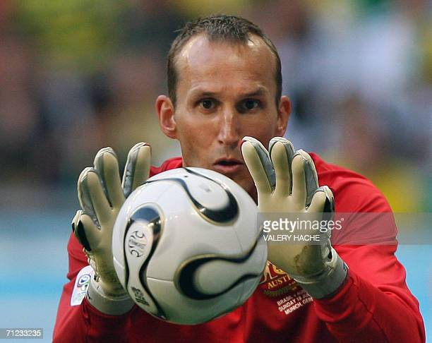 Australian goalkeeper Mark Schwarzer grabs the ball during action against Brazil in their opening round Group F World Cup football match at Munich's...