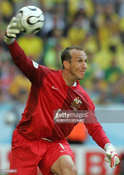 Australian goalkeeper Mark Schwarzer throws the ball back in against Brazil in their opening round Group F World Cup football match at Munich's World...