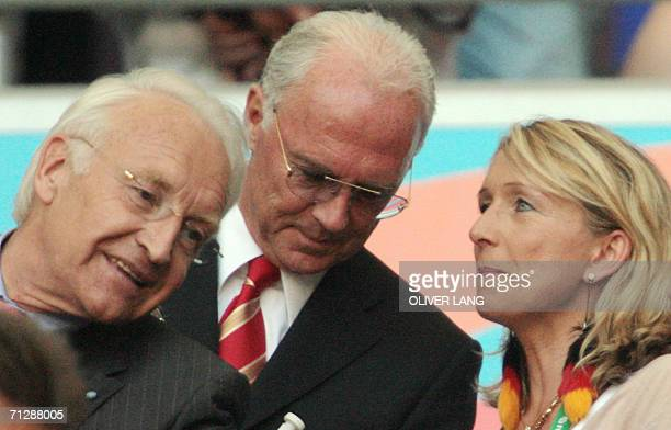 Bavaria State Minister Edmund Stoiber speaks with Franz Beckenbauer chief of the World Cup Organising Committee and former German football great and...