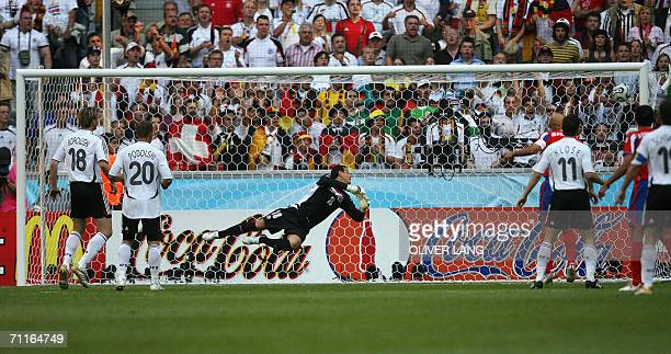 Costa Rican goalkeeper Jose Porras dives after a goal by German defender Philipp Lahm in the first half of their opening match at Munich's World Cup...