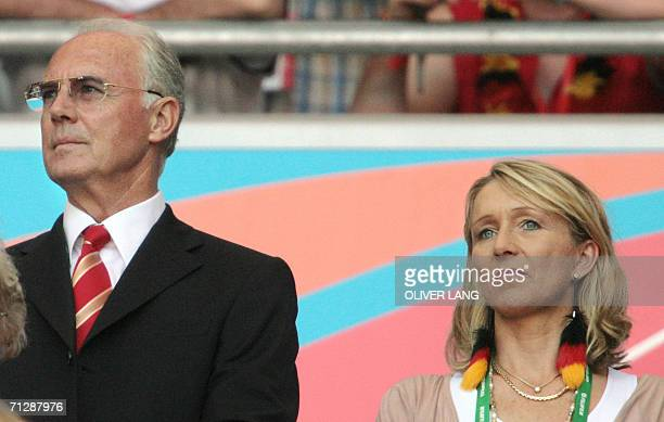 Franz Beckenbauer chief of the World Cup Organising Committee and former German football great and his new wife Heidrun Burmester attend the round of...