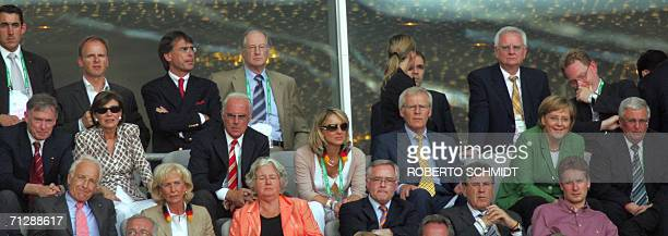 German President Horst Koehler his wife Franz Beckenbauer chief of the World Cup Organising Committee and former German football great his new wife...