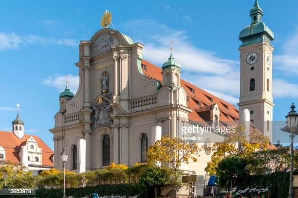 munich germany old famous historical church heilig-geist-kirche in old town - kirche stock pictures, royalty-free photos & images