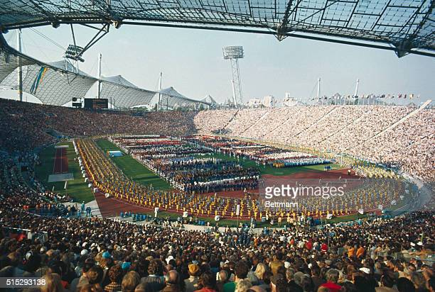 Munich, Germany. Olympic Stadium is packed with some 80,000 people as the finest amateur athletes in the world parade on the field below. Slide shows...