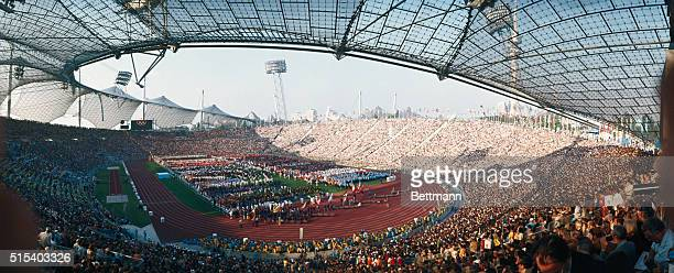 Munich Germany Olympic Stadium is packed with some 80000 people as the finest amateur athletes in the world parade on the field below Slide shows...