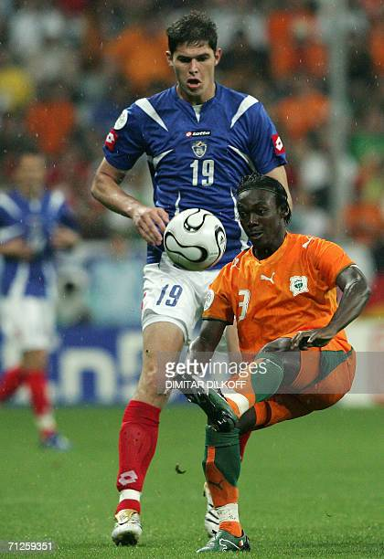 Serbia and Montenegro's forward Nikola Zigic challenges Ivorian defender Arthur Boka during the opening round Group C World Cup football match...
