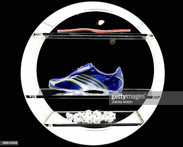The new Adidas football shoe 'F50 Tunit' is presented 13 February 2006 in Munich The German maker of sportswear and equipment Adidas launched its...